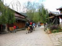 People Riding Horses at Shuhe Old Town Lijiang